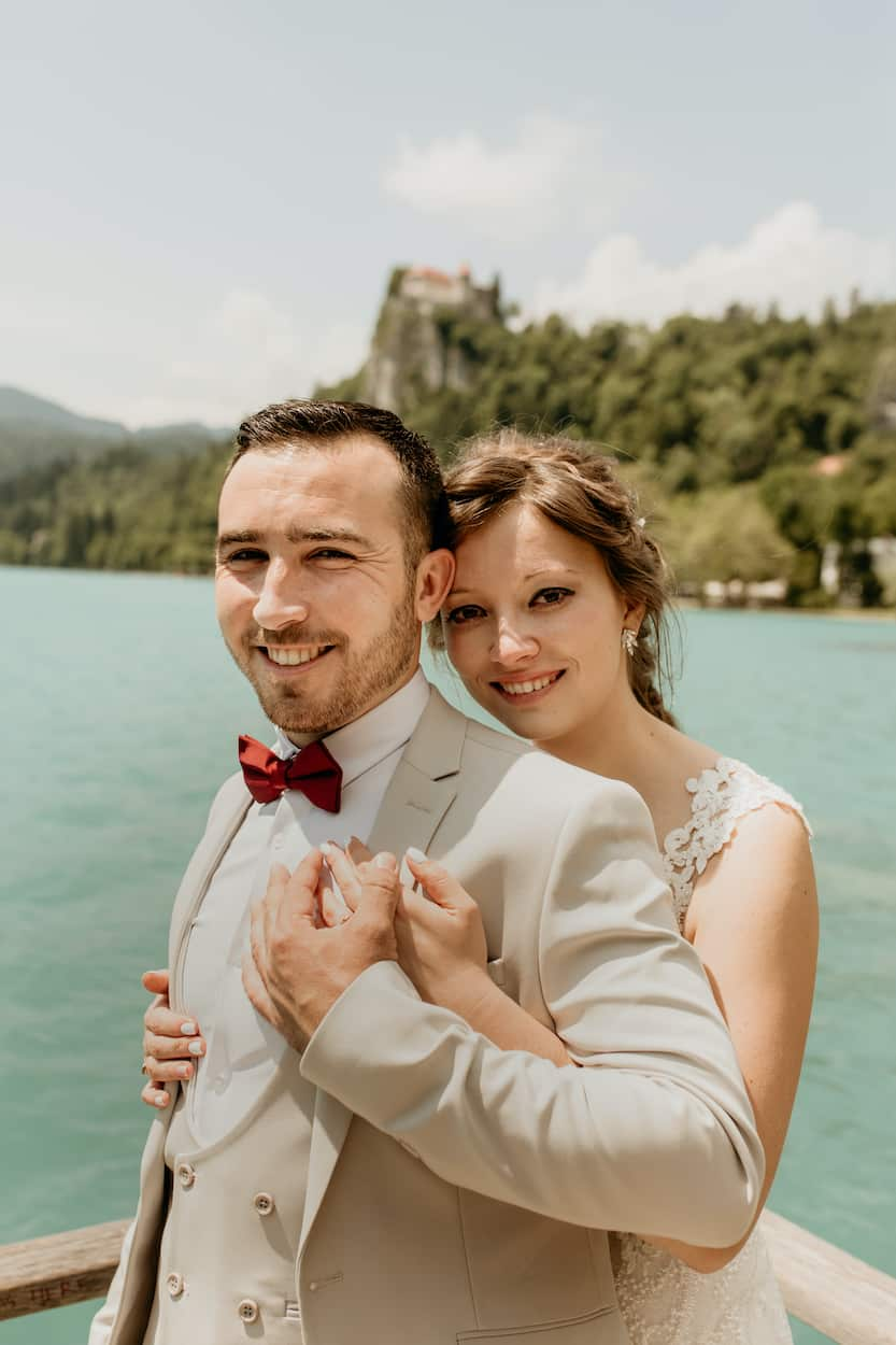 Couple hugging for Lake Bled wedding portfolio