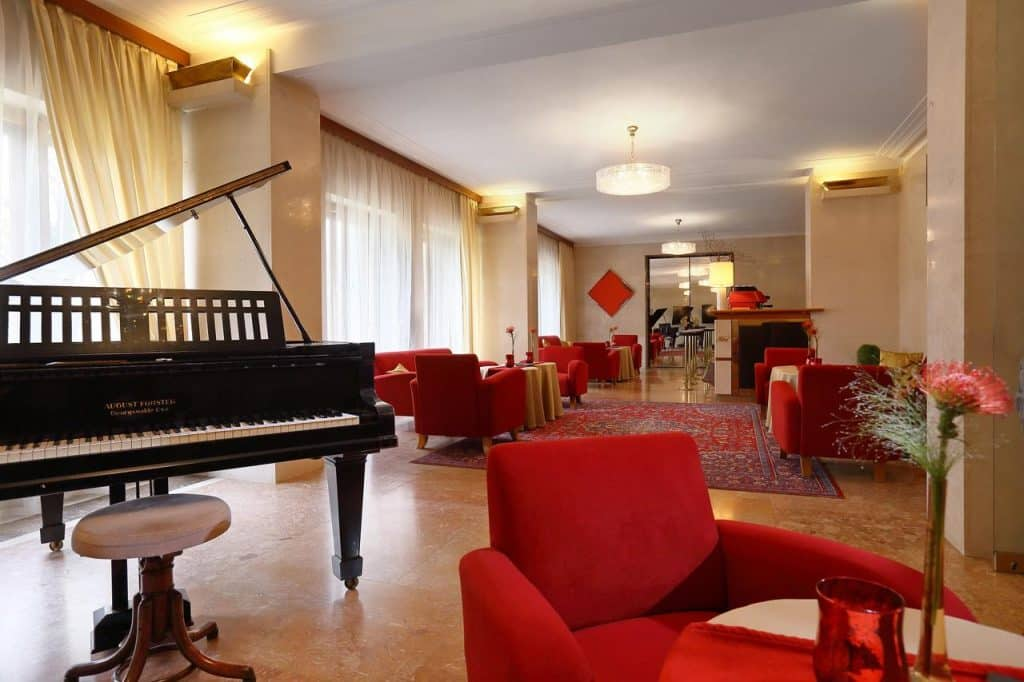 Lake Bled wedding accommodation Vila Bled lobby with piano