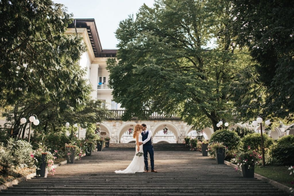 Bride and groom hugging on the stars before Villa Bled wedding