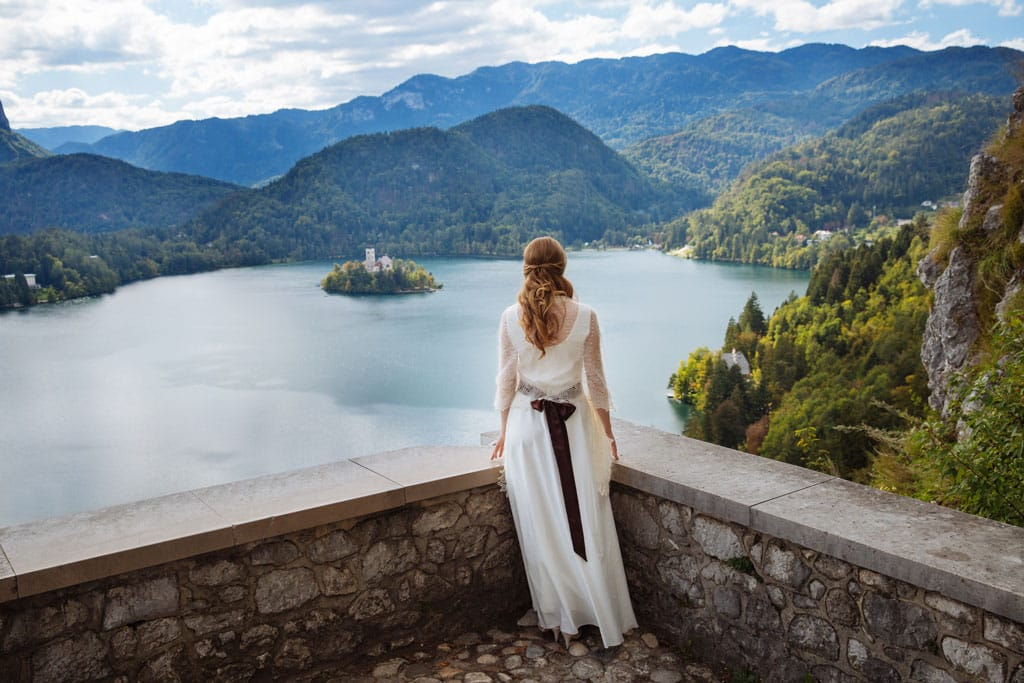 Bride on Bled castle with Lake Bled in background