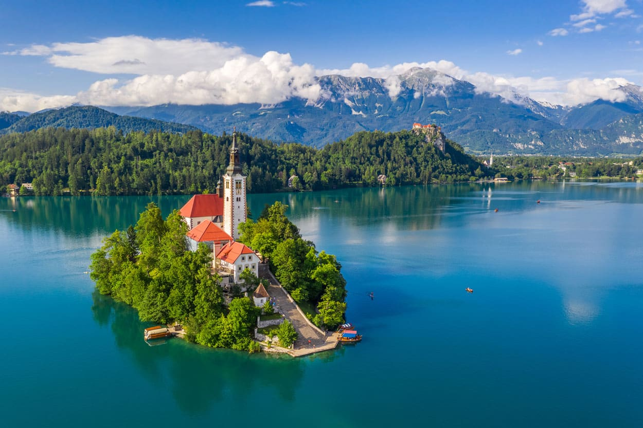 Lake Bled island with alps in the back