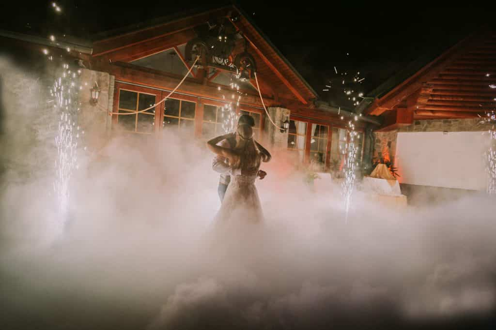 Married couple surrounded by smoke dance at their Wedding at Lake Bled