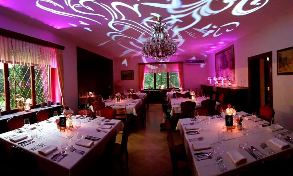 Tables inside for the Lake Bled wedding reception and lights
