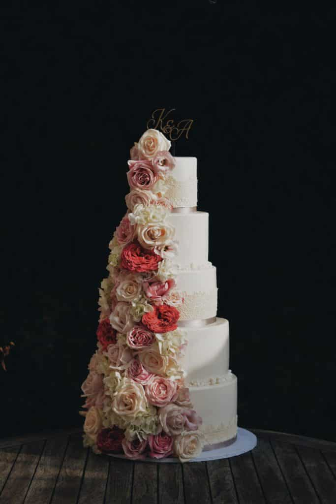 Classy cake with flowers prepared by Lake Bled wedding suppliers