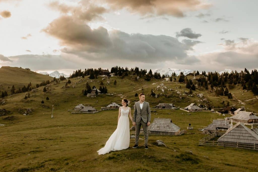 Lake Bled wedding supplier photo of bride and groom holding hands at Velika Planina