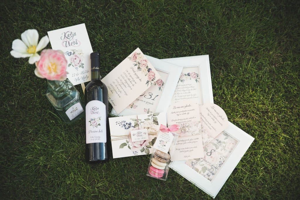 Lake Bled wedding suppliers bottle of wine, flowers, macrons and cards