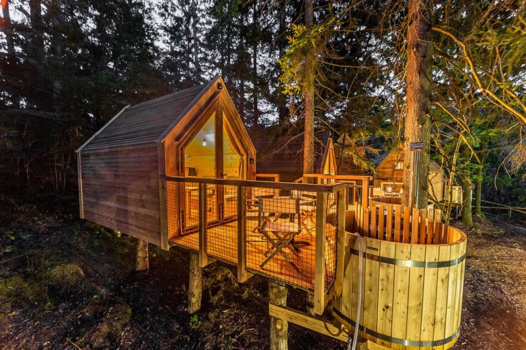 Glamping houses with the bathtubs outside at Lake Bled