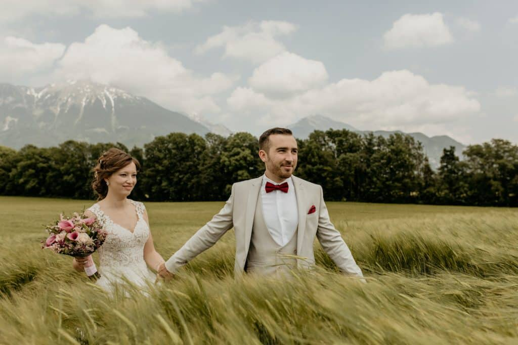 Elopement couple on the field in Bled
