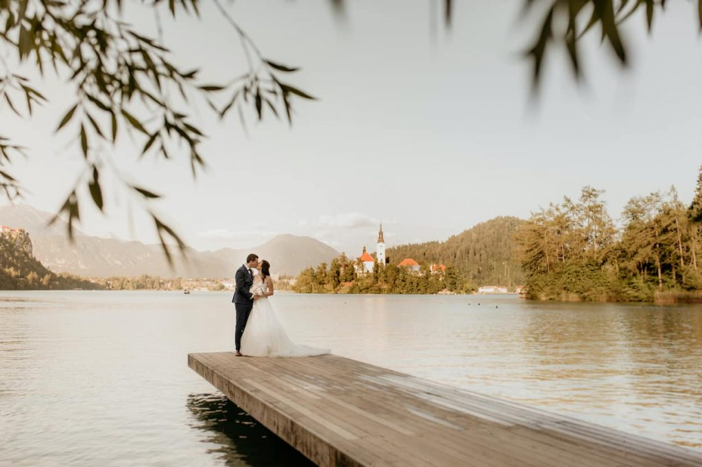 Elopement couple standing in front of Lake Bled