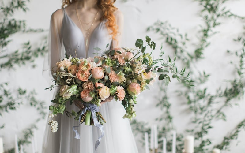 Lake Bled elopement flower bouquet in the bride's hands
