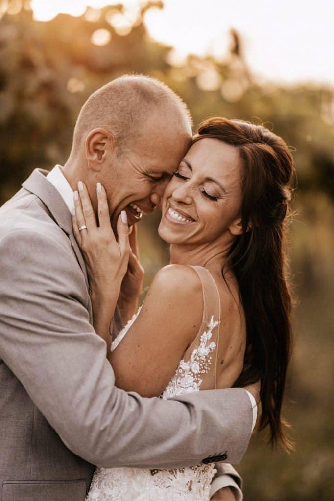 Bride hugs the groom after her Lake Bled wedding supplier's makeup