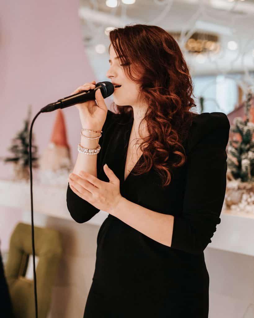 Lady singing at Lake Bled Wedding