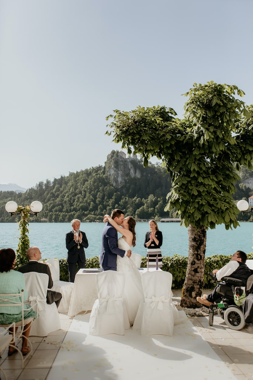Bride and groom kiss at civil ceremony at Lake Bled wedding portfolio