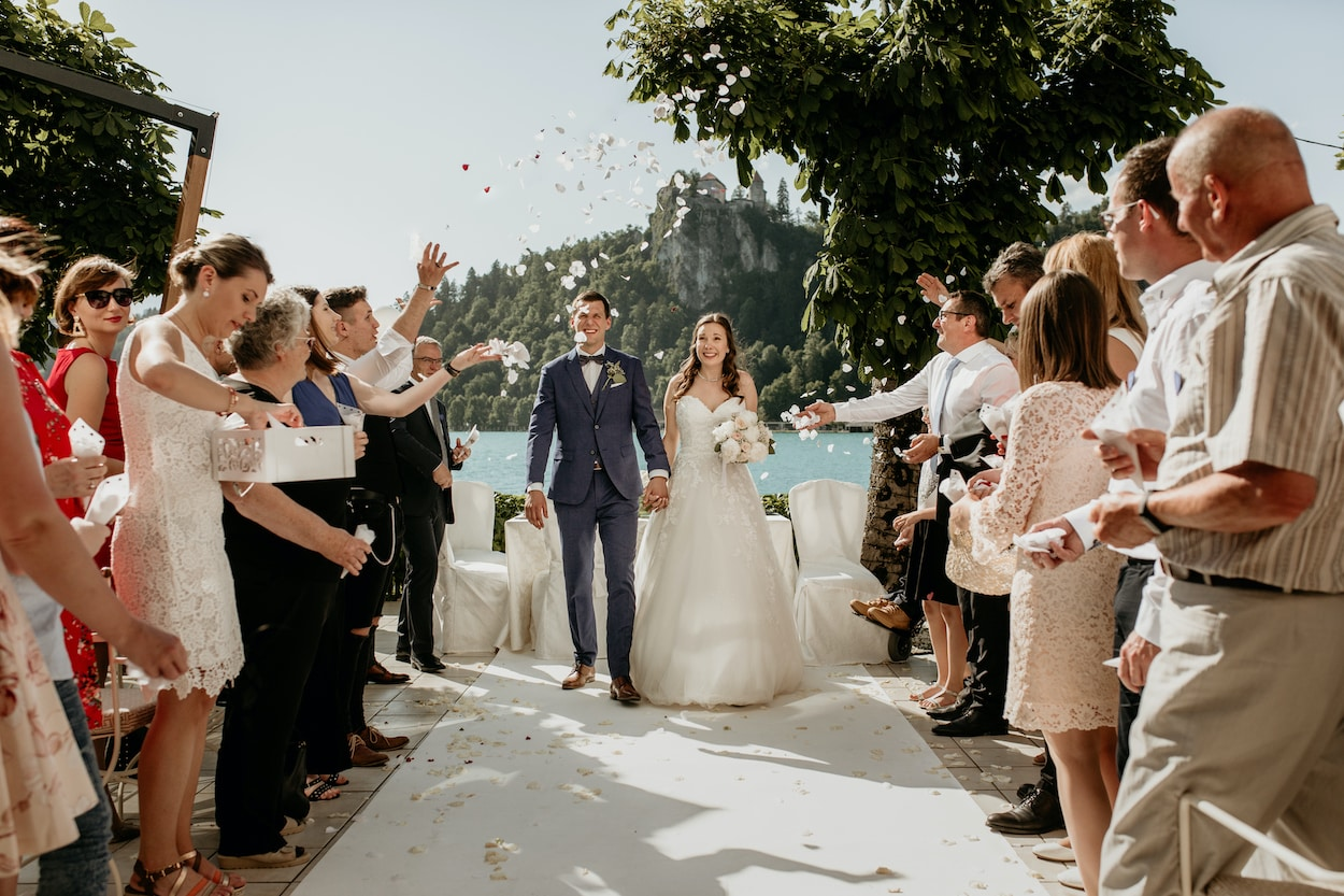 Just married couple and confetti shower from Lake Bled wedding portfolio