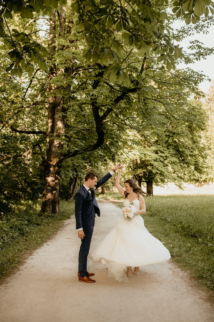 Lake Bled wedding portfolio photo of bride and groom dancing on the road