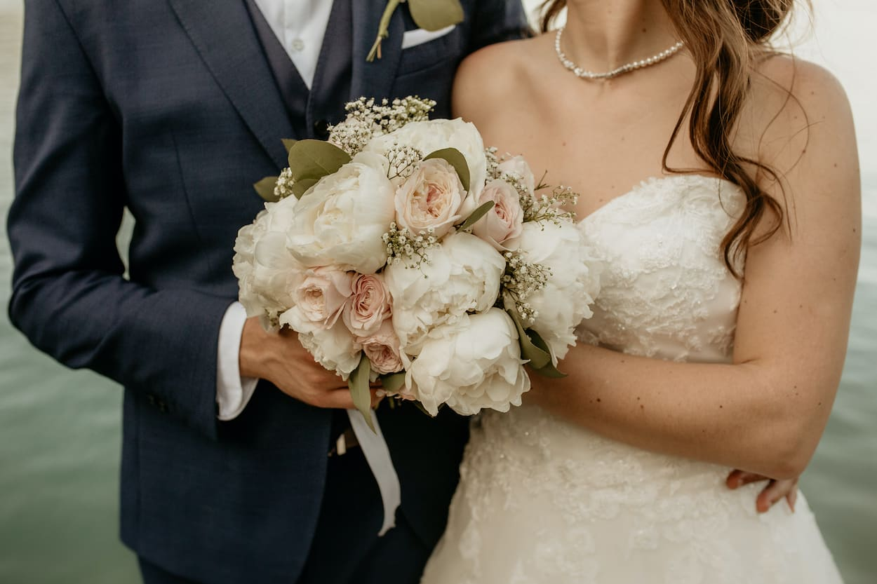 Close shot of couple holding bouquet from Lake Bled wedding portfolio