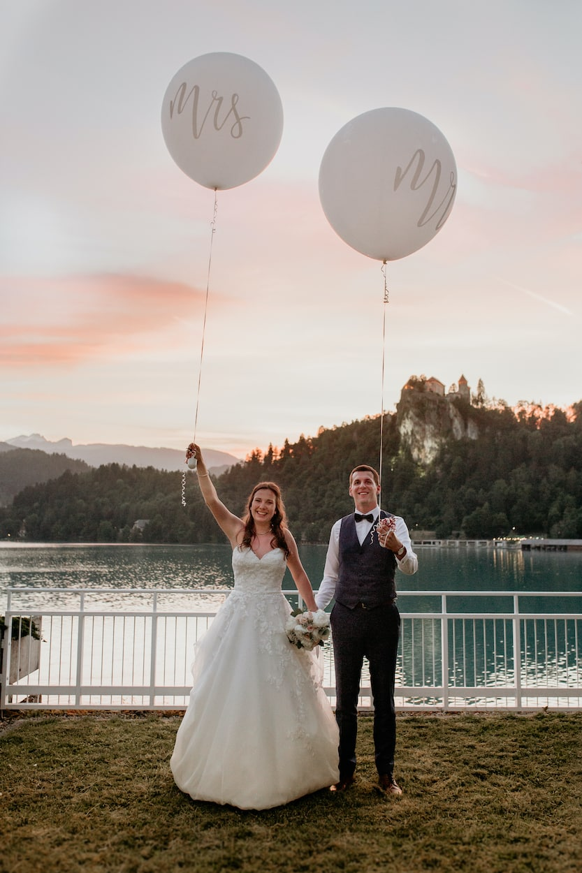 Bride and groom with Mr and Mrs Balloon from Lake Bled wedding portfolio
