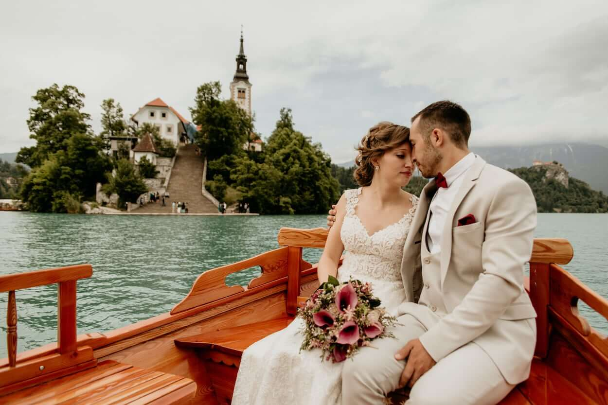 Bride and groom hug in the boat after their Bled Island wedding