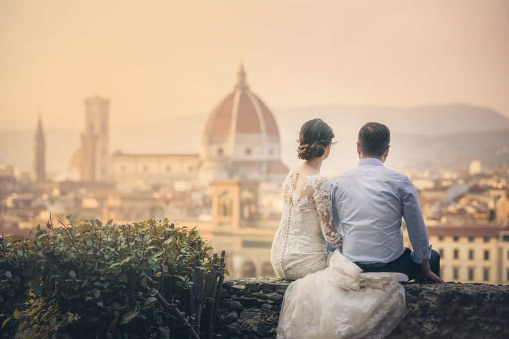 Bride and groom sitting and watching Florence