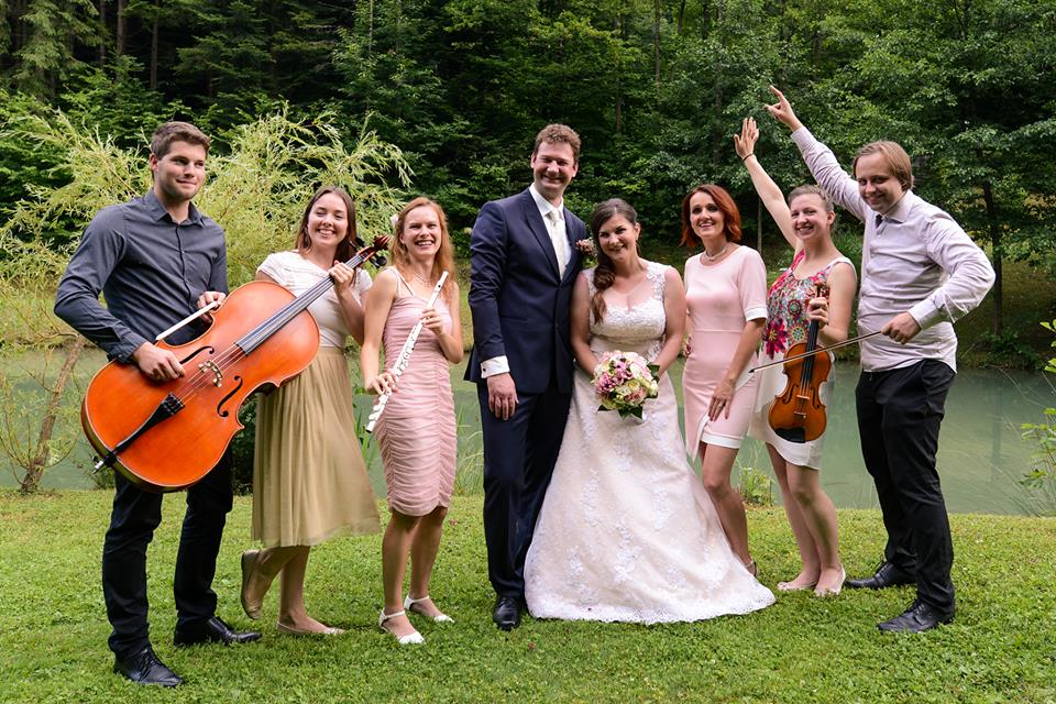 Artistik Band posing with bride and groom