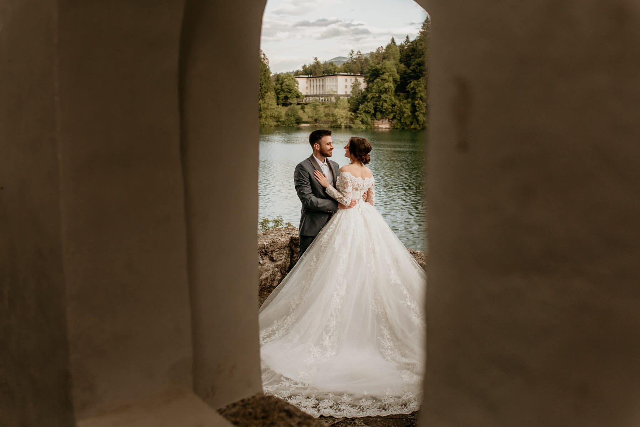 Bride and groom together viewed from the Bled Island chapel doors