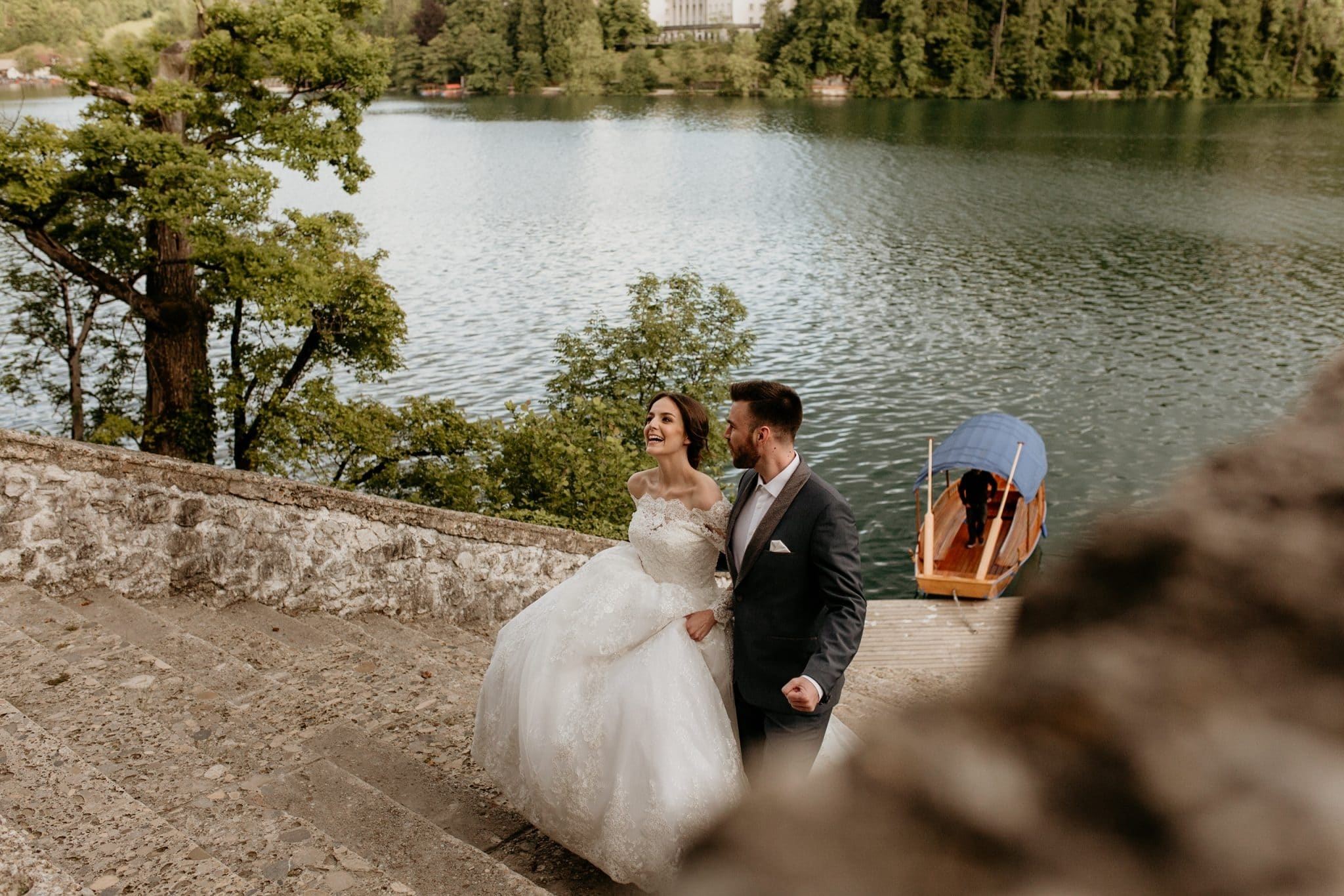 Bride and groom on the Bled Island stairs