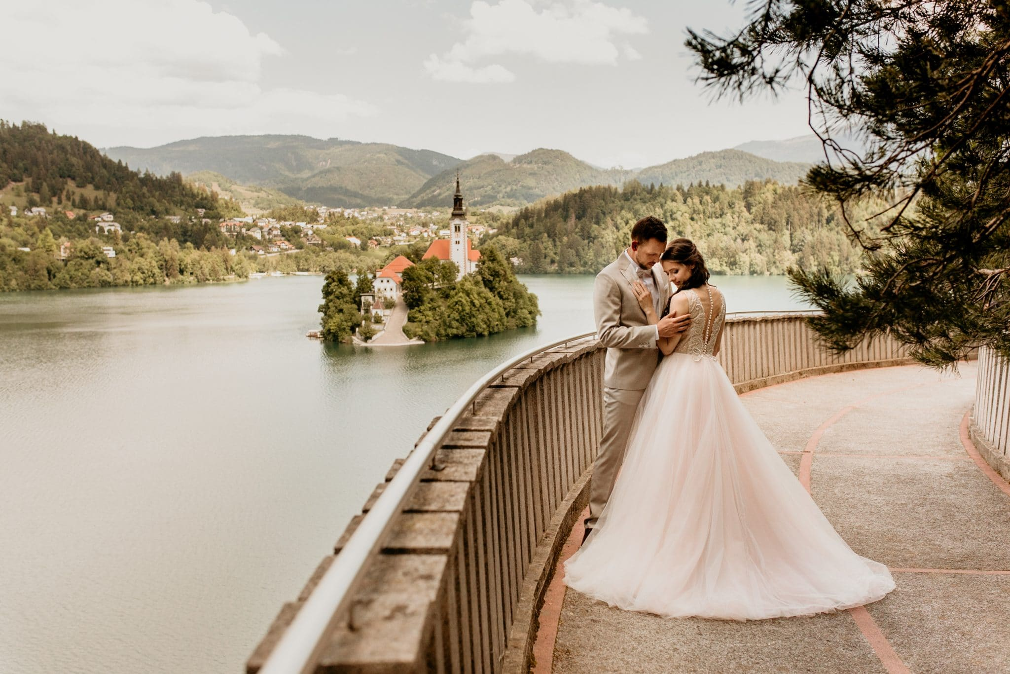 Bride and groom at Lake Bled with Bled Island in the background