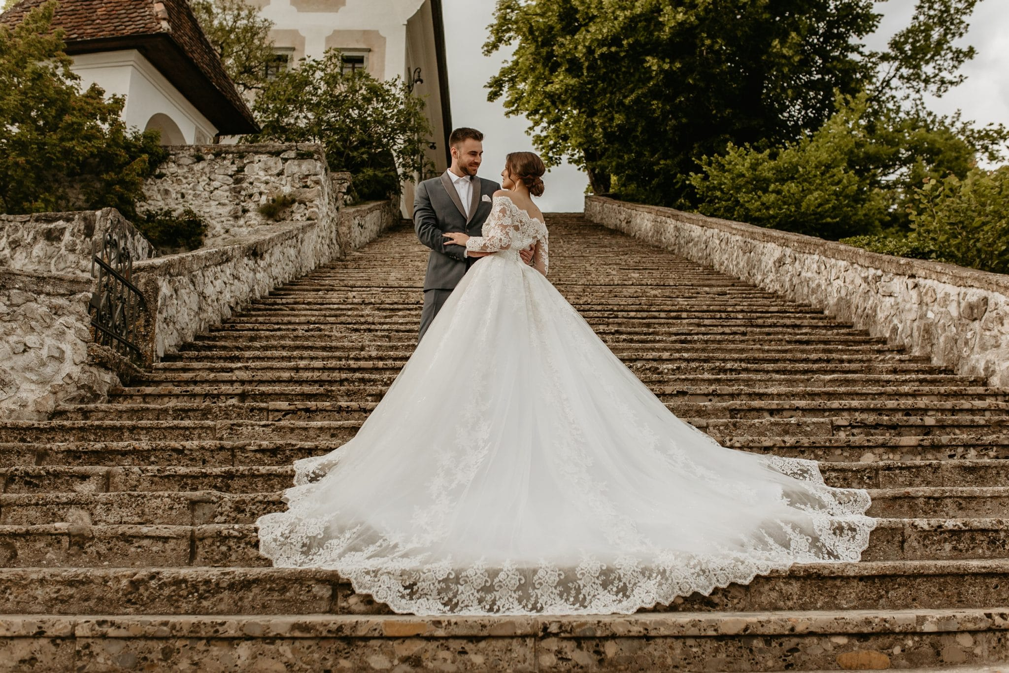 Bride and groom on the stairs to Lake Bled island church