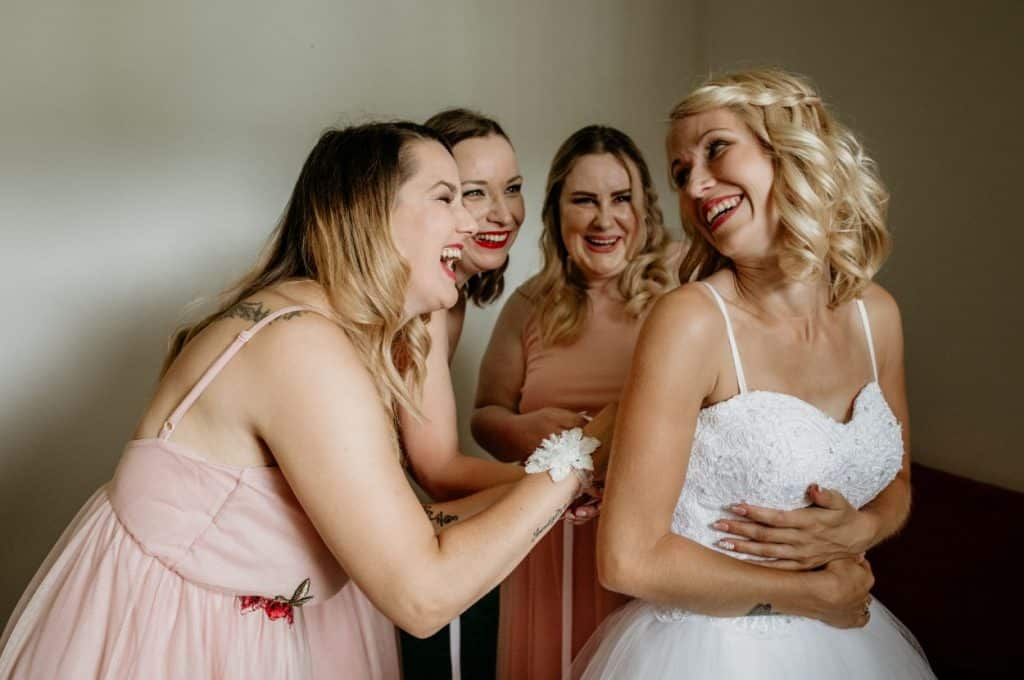 Bride and the bridesmates getting ready.