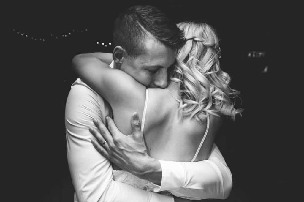 Bride and groom huging.