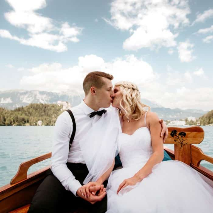 Bride-and-groom-in-boat-on-lake-Bled-Town-Hall-wedding