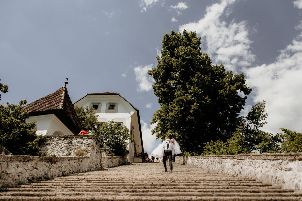 Bride-and-groom-on-stairs-Bled-Town-Hall-wedding