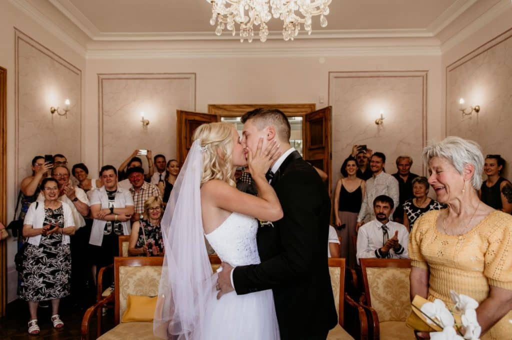 Wedding couple kiss after ceremony.