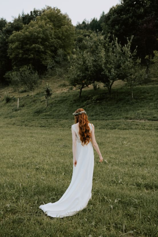 Bride in nature on meadow.