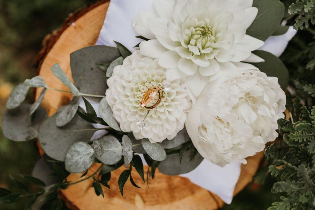Wedding rings on a flower.