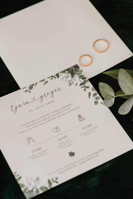 Invitaion for a wedding and wedding rings.