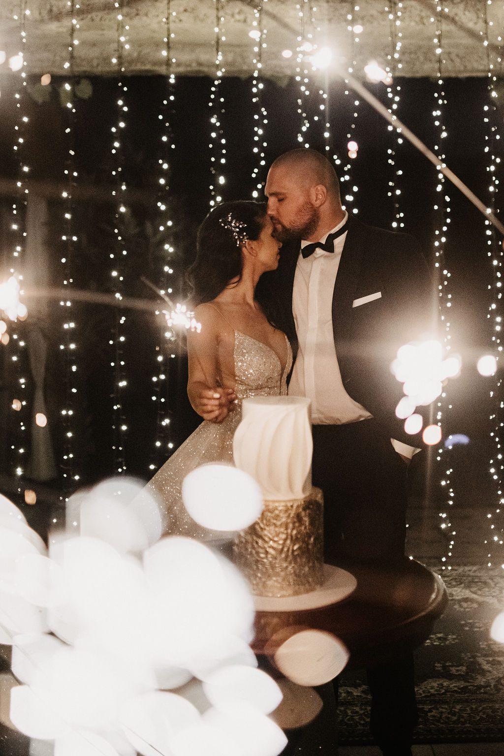 Bride and groom in the glow of fierflies.