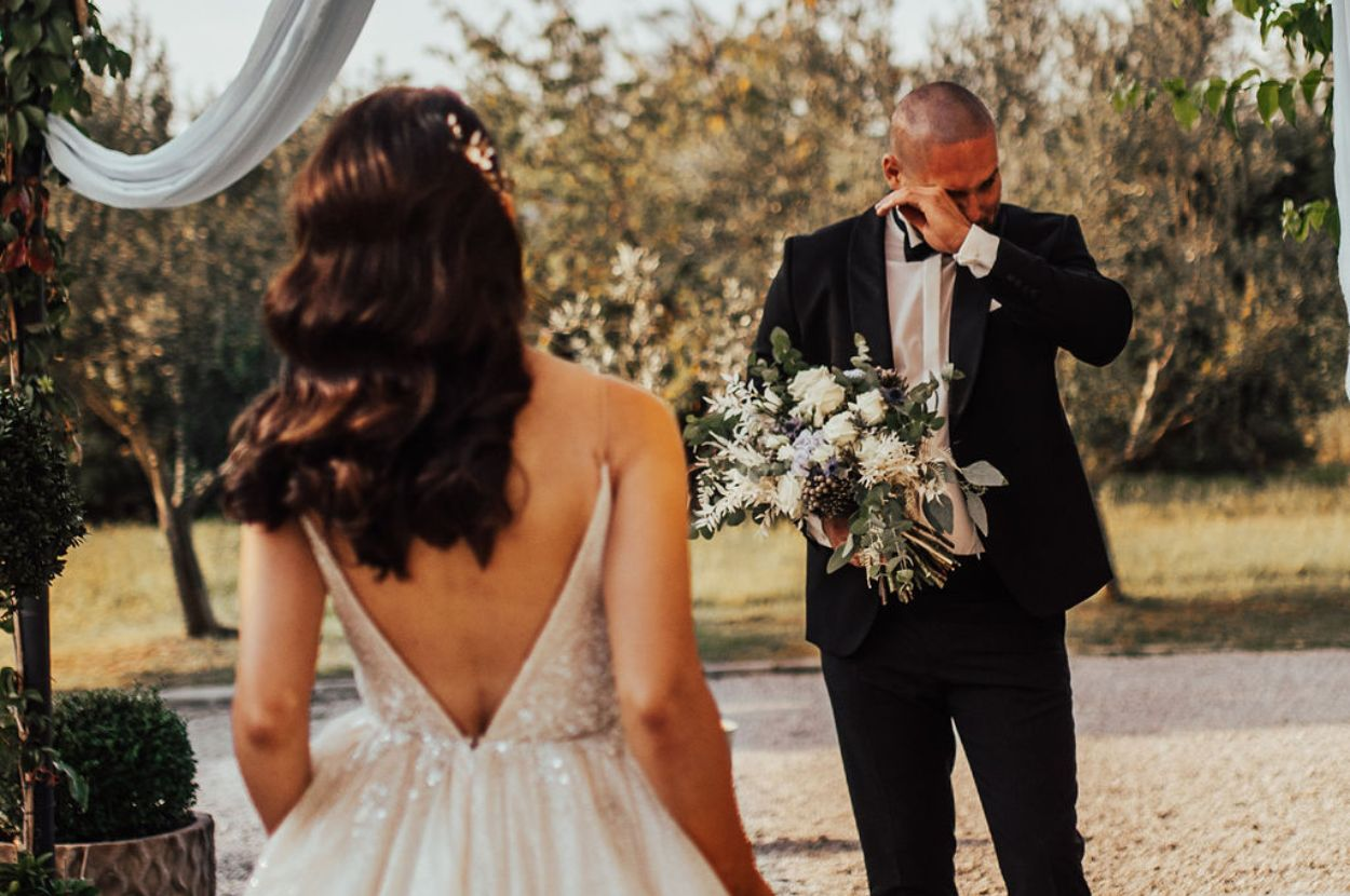 The groom in tears at the sight of his bride.