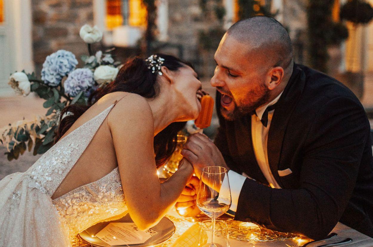 Bride and groom eating icecream.