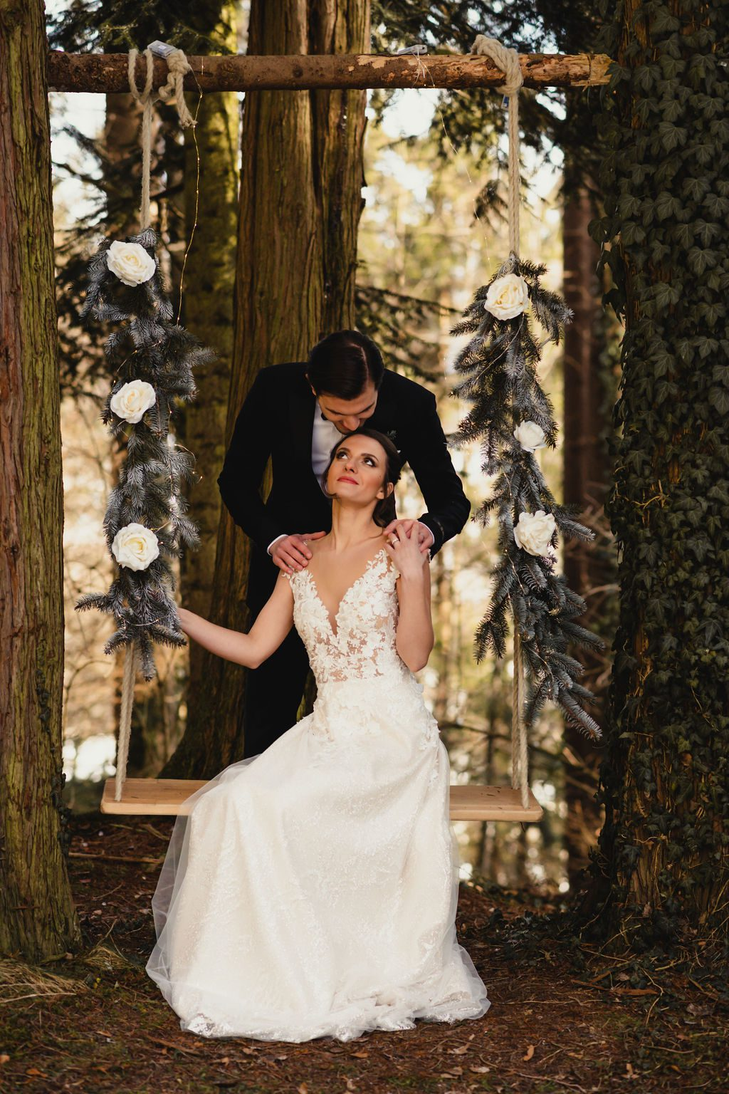 Bride and groom on a swing.