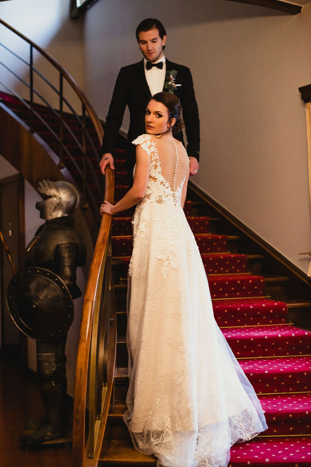 Bride and groom on stairs.