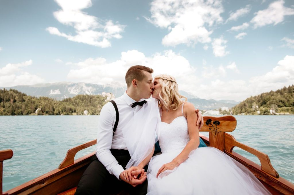 Wedding couple in boat on the lake.