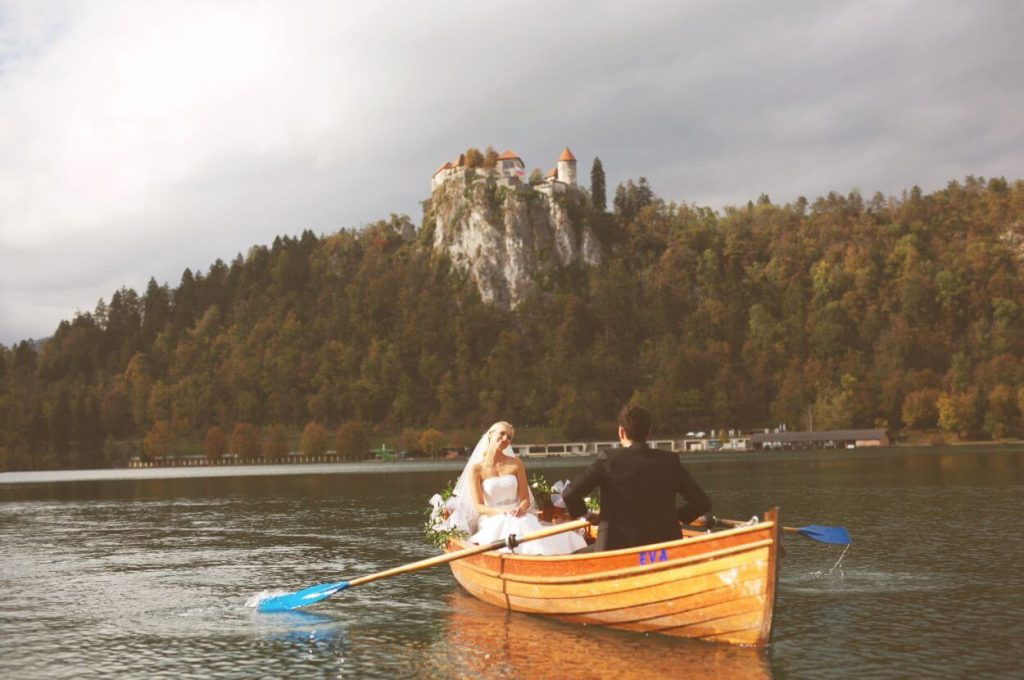 Wedding couple on the lake in boat.