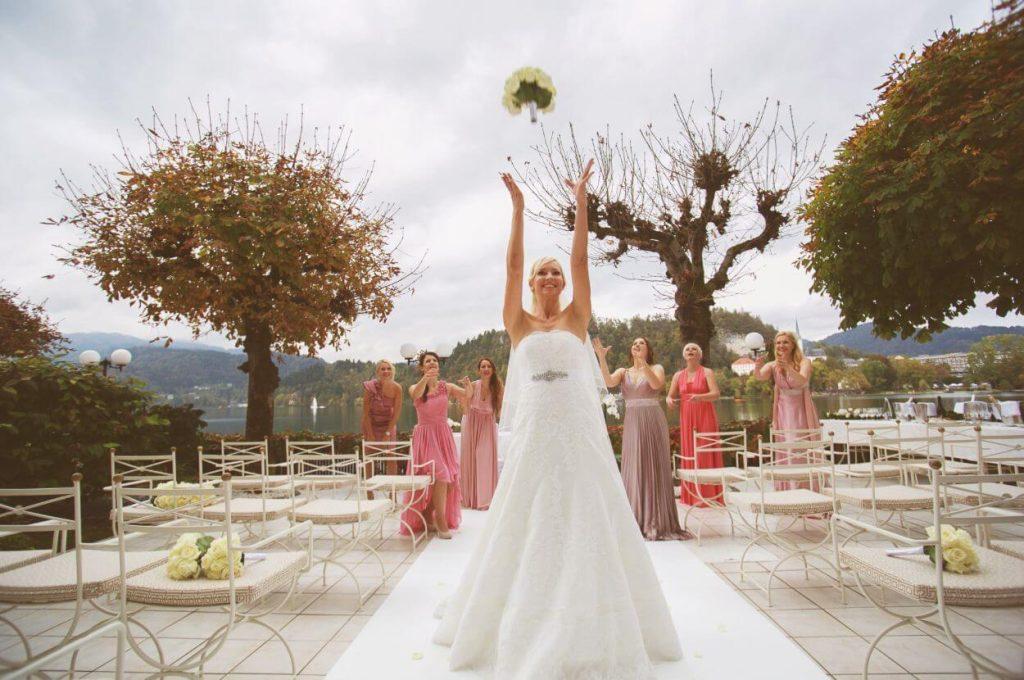 Bride is throwing her bouquet.